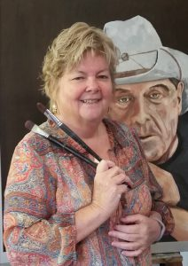 Zoe Graham in front of her portrait of Molly Meldrum